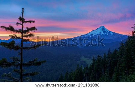 Majestic View of Mt. Hood on a bright, colorful sunset during the summer months. - stock photo