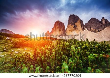 Majestic view of the National Park Tre Cime di Lavaredo with rifugio Locatelli. Dolomites, South Tyrol. Location Auronzo, Italy, Europe. Dramatic scene. Beauty world. - stock photo