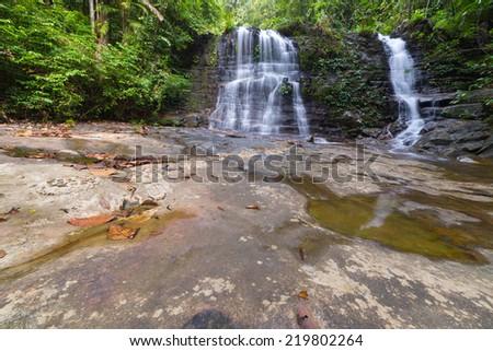 Majestic waterfall in the dense rainforest of Kubah National Park, West sarawak, Borneo, Malaysia. - stock photo