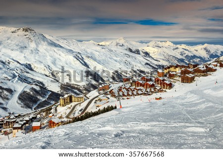 Majestic winter landscape and ski resort with typical alpine wooden houses in French Alps,Les Menuires,3 Vallees,France,Europe - stock photo