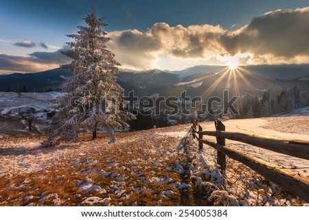 Majestic winter landscape glowing by sunlight. Dramatic wintry scene. - stock photo