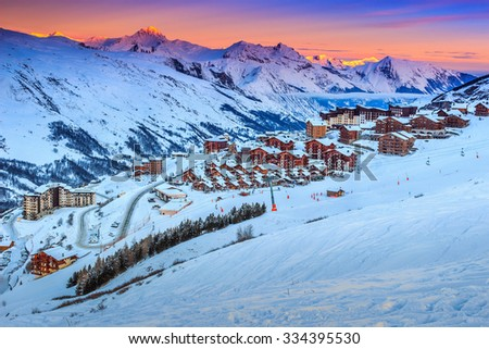 Majestic winter sunrise landscape and ski resort with typical alpine wooden houses in French Alps,Les Menuires,3 Vallees,France,Europe - stock photo