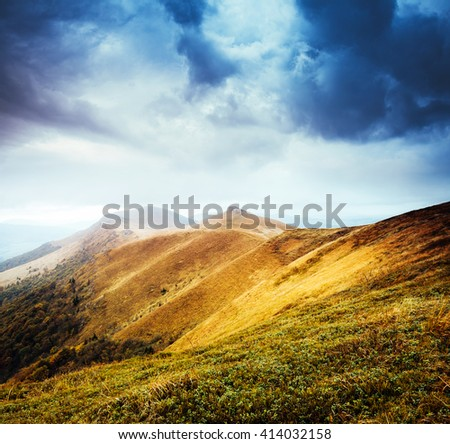 Majestic yellow hills glowing by sunlight a day. Dramatic scene and picturesque picture. Location place Carpathian, Ukraine, Europe. Beauty world. Retro and vintage style. Instagram toning effect. - stock photo