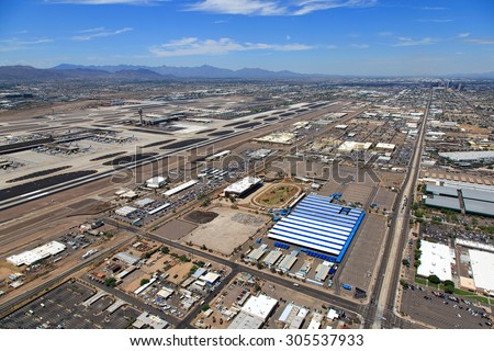 Major Airport viewed from above a swap meet site, former home to dog racing in Phoenix, Arizona