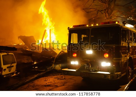 Major building fire with fire engine, smoke and heavy flame. - stock photo