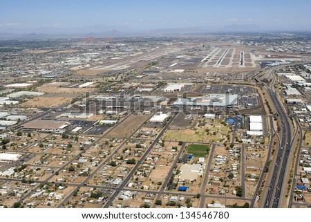 Major international airport aerial view with rental car center and Interstate 10 access - stock photo