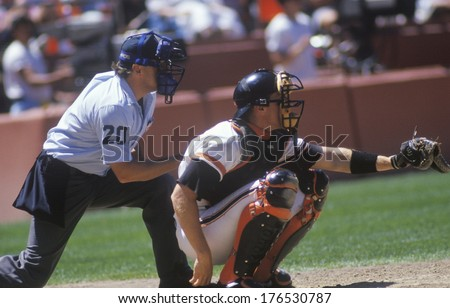 Major league catcher and umpire behind home plate