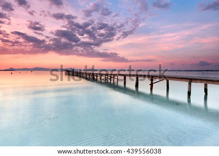 Majorca Platja de Muro beach pier at sunrise in Alcudia bay in Mallorca Balearic islands of Spain