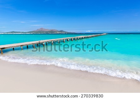 Majorca Platja de Muro beach pier in Alcudia bay in Mallorca Balearic islands of Spain - stock photo