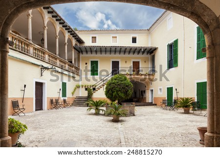 MAJORCA, SPAIN - AUGUST 17, 2013: View of the patio of an old rustic house in Majorca, Spain on Aug 17, 2013