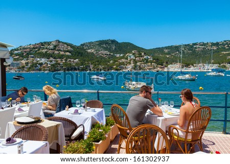 MAJORCA, SPAIN - JUNE 01: Tourists having lunch in Puerto de Andratx, one of the most important and exclusive landmarks in Majorca due to its nautical activity, on June 01, 2013 in Majorca, Spain