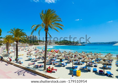 MAJORCA, SPAIN - MAY 31: People sunbathing at Paguera Beach, a spanish tourist village belonging to the municipality of Calvia offering 3 great beaches, on May 31, 2013 in Majorca, Spain - stock photo