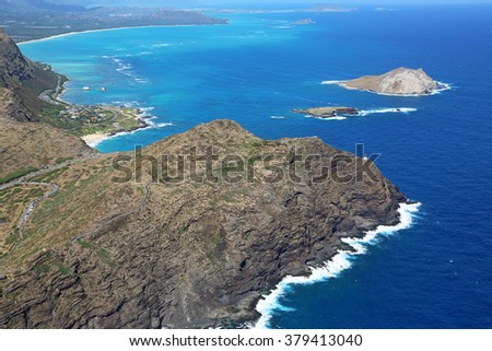 Makapuu Point with lighthouse - view from helicopter, Oahu, Hawaii - stock photo