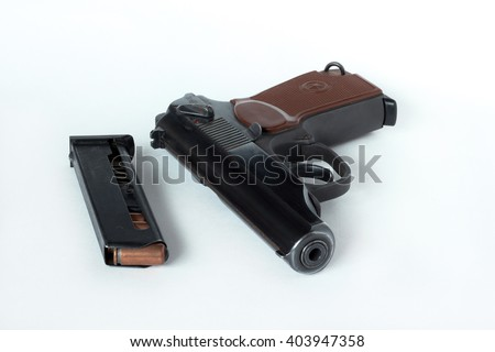 Makarov pistol and cartridges. Isolated on a white background. - stock photo