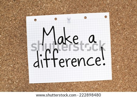 Make a Difference Motivational Phrase on Cork Board - stock photo