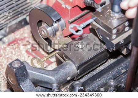 make a metal key locksmith - stock photo