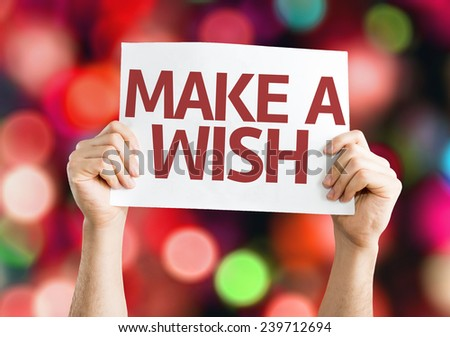 Make a Wish card with colorful background with defocused lights - stock photo