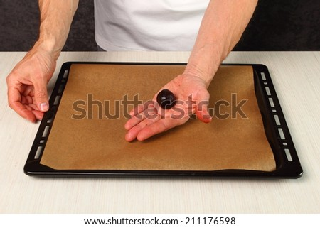 Make ball from cookie dough. Making Chocolate Cookies. - stock photo