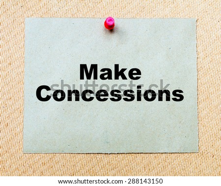 Make Concessions written on paper note pinned with red thumbtack on wooden board. Business conceptual Image - stock photo