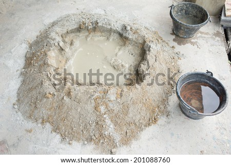 make concrete pile with bucket full water - stock photo