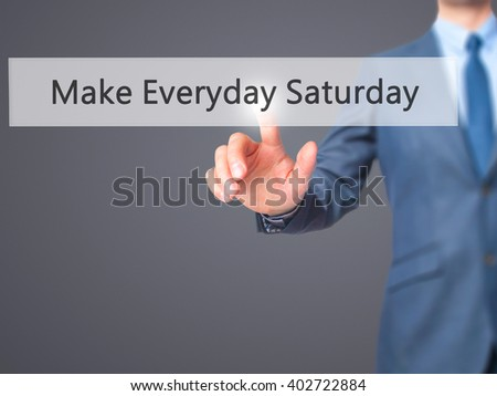 Make Everyday Saturday - Businessman hand pressing button on touch screen interface. Business, technology, internet concept. Stock Photo