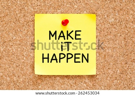 Make it Happen handwritten on yellow sticky note. - stock photo