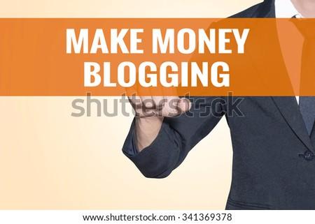 Make Money Blogging word Business man touch on virtual screen orange background - stock photo