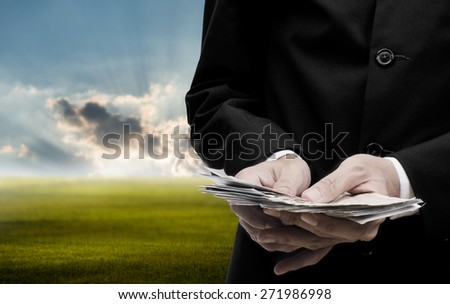 Make money concept, Businessman count the banknote at morning - stock photo