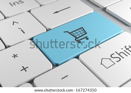 Make online purchases directly using a blue button with shopping cart icon in a elegant keyboard - stock photo