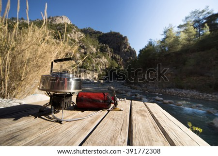 Make tea in a hike in the woods in summer. - stock photo
