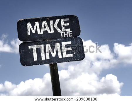 Make The Time sign with clouds and sky background  - stock photo