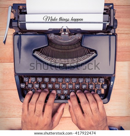 Make things happen message against businessman typing on typewriter