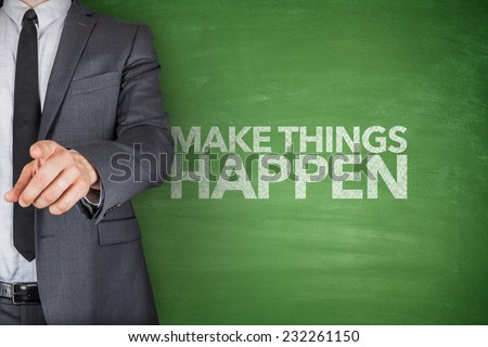 Make things happen on blackboard with businessman - stock photo