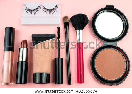 Make Up Accessories on Pink background.