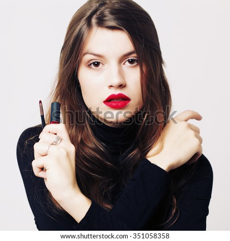 Make-up and cosmetics. Beautiful model girl makeup. Perfect skin. Professional make up. Red lips - stock photo