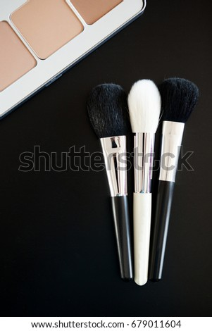 Make up and cosmetics products on black background. Professional Cosmetics