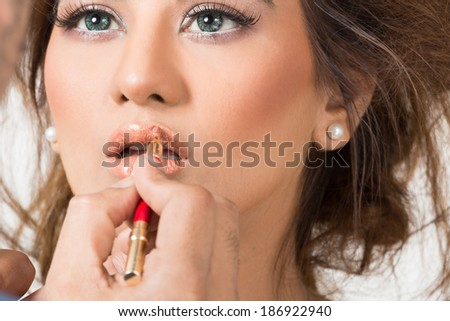 make up artist applying lipstick  - stock photo