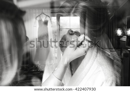 Make up artist applying make up to a fashion bride
