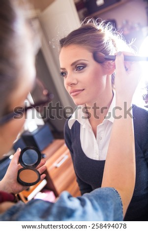 Make-up artist work in her studio. - stock photo