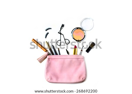 make up bag with cosmetics and brushes isolated on white background - stock photo