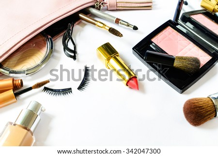 make up bag with cosmetics and brushes isolated on white with copy space - stock photo