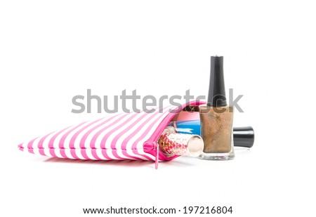 Make up bag with Nail polish on white - stock photo