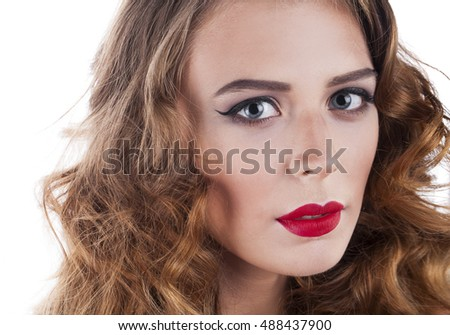Make Up. Beautiful Blonde Girl. Healthy Long Curly Hair. Isolated on white background