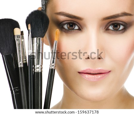 make up , beauty woman face, brushes, portrait of attractive young caucasian girl brunette , close up , isolated on white , studio shot , head and shoulders, looking at camera, eyes, lips - stock photo
