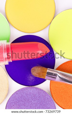 Make-up brush and lipstick on professional eyeshadows palette, closeup - stock photo