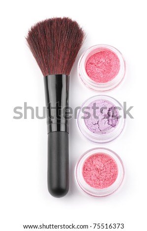 Make-up brush and powder eye shadows in jars isolated on white background.