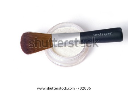 make up brush laying over glittering powder - stock photo
