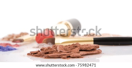 Make-up brush, lipstick and different powder isolated on white background - stock photo