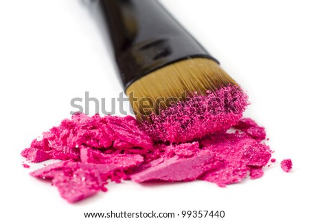 Make-up brush pink crushed eyeshadows - stock photo