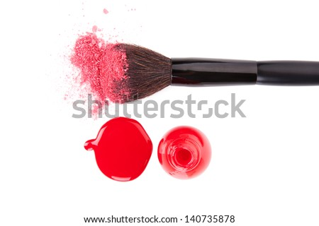 Make up brush with pink facial powder and red nail polish and splatter isolated on white background, top view with clipping path. Feminine make up and cosmetics still life. - stock photo